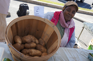 Lucia from Shamba Farms at the West End Farmers Market taken by Knerq