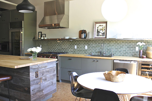 kitchen with reclaimed wood island and cork floors in a wine country home by Krista Schrock and David John Dick