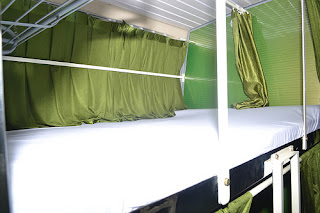 Inside view of Greenline AC Sleeper coach from Bangalore to Munnar