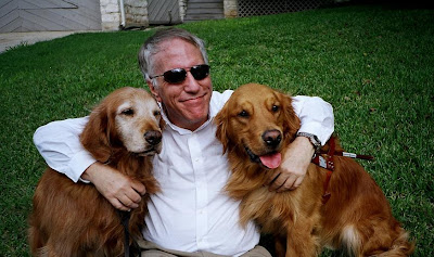 Morgan Watkins with his retired Guide Dog Fantom and his current Guide Dog Will, both Golden Retrievers
