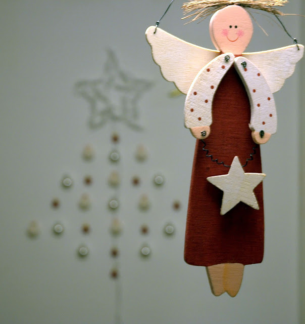 Eco-friendly Christmas tree from balls with lightning star and little wood angel