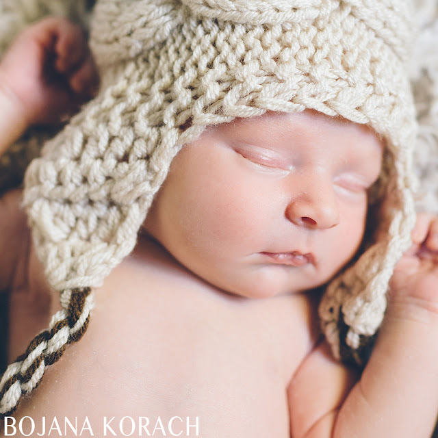 newborn baby boy wearing a natural color knit hat in san francisco bay area