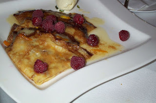 Crêpe Suzette with raspberries photo by StuSpivack at Flickr