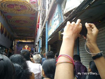 People capture theLord ganesh Image in their cameras at the Lalbaugcha Raja, Ganesh Pandal during Ganesh Chaturthi celebrations