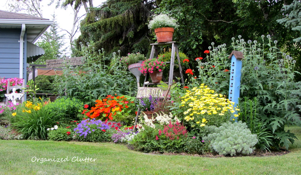 mixed annual perennial junk garden - Front Yard Cottage Garden Ideas