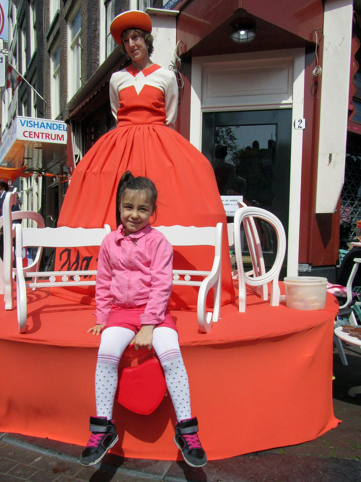 little girl posing with the 'Queen'