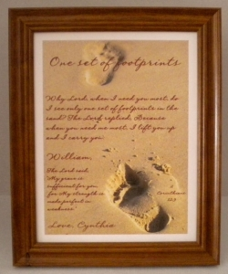 http://storesonline.com/site/444851/product/personalized_footprints_inthe_sand_print2