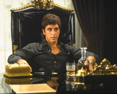 al pacino as tony montana in scarface (1983), famous pose sitting on chair, Directed by Brian De Palma