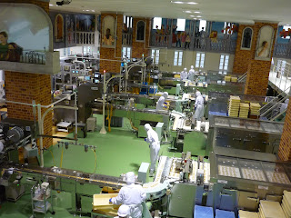 Factory floor at the shiroi koibito biscuit factory shoing the many different production lines as well as art around the walls