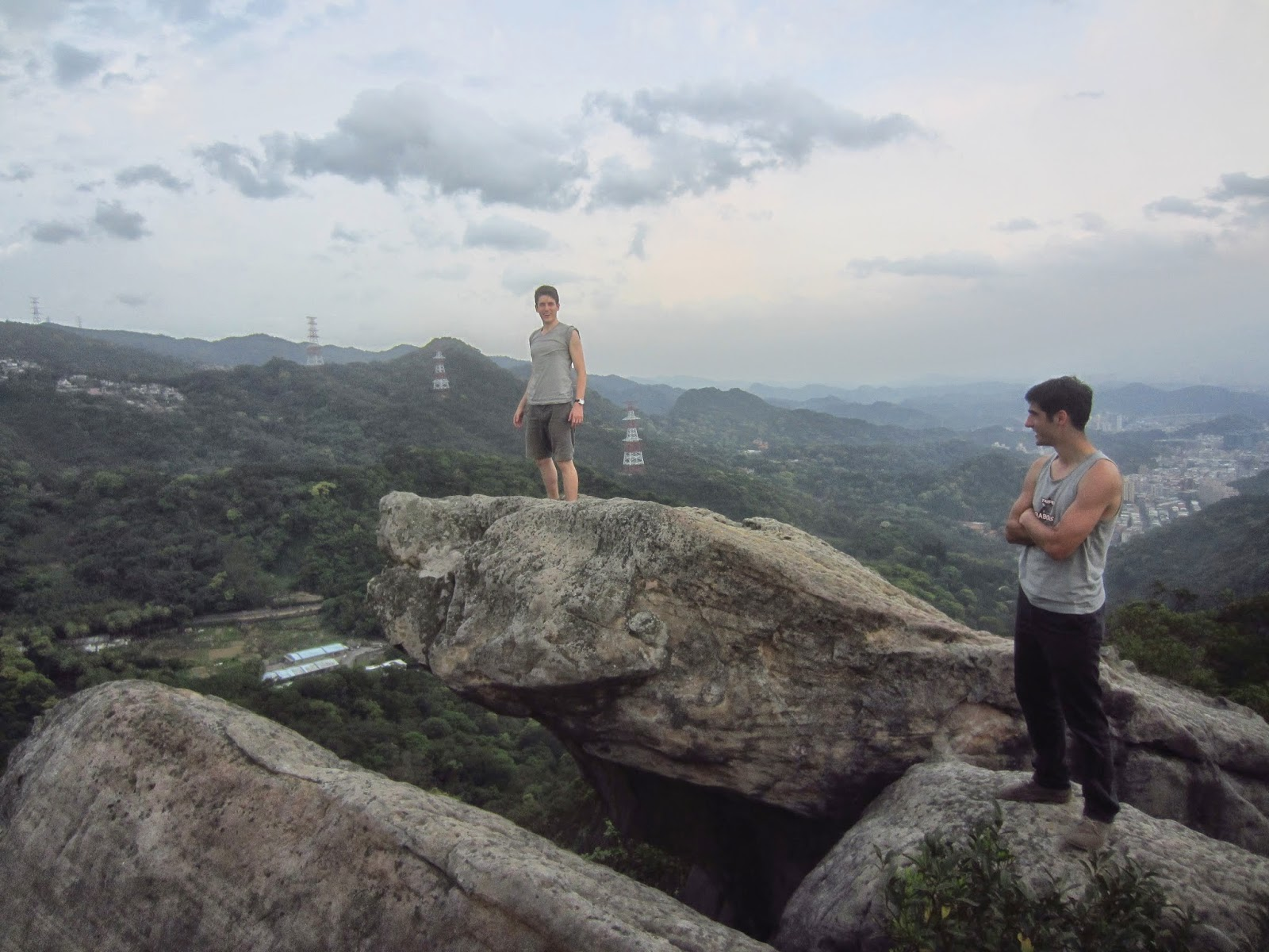Thomas and I standing on large boulders at Gold Side Mountain, Taipei, Taiwan