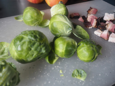 brussel sprouts and bacon on a chipping board