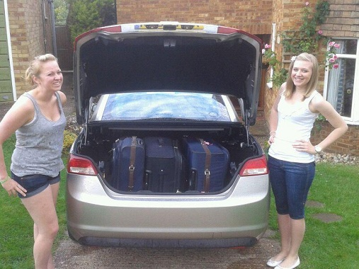 Girls pre-Cannes by car packed with suitcases