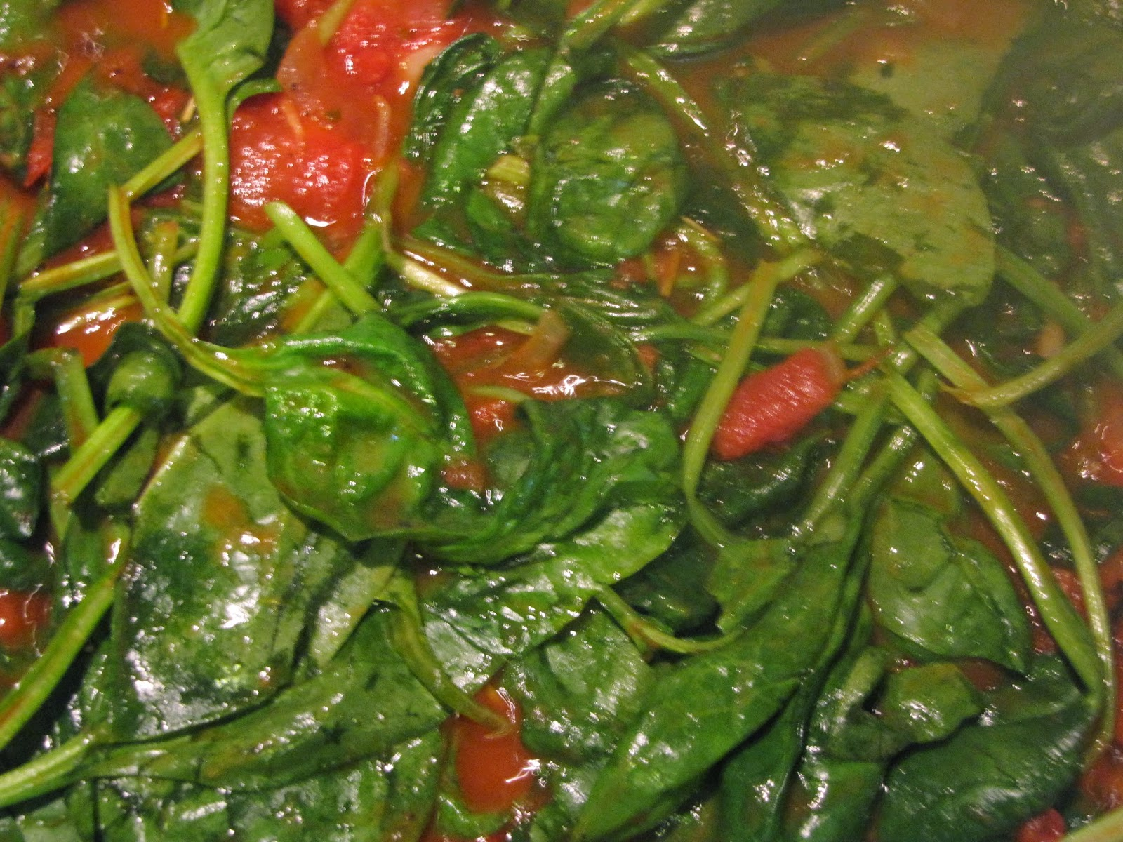 Partly Wilted Spinach Leaves in Tomato Sauce