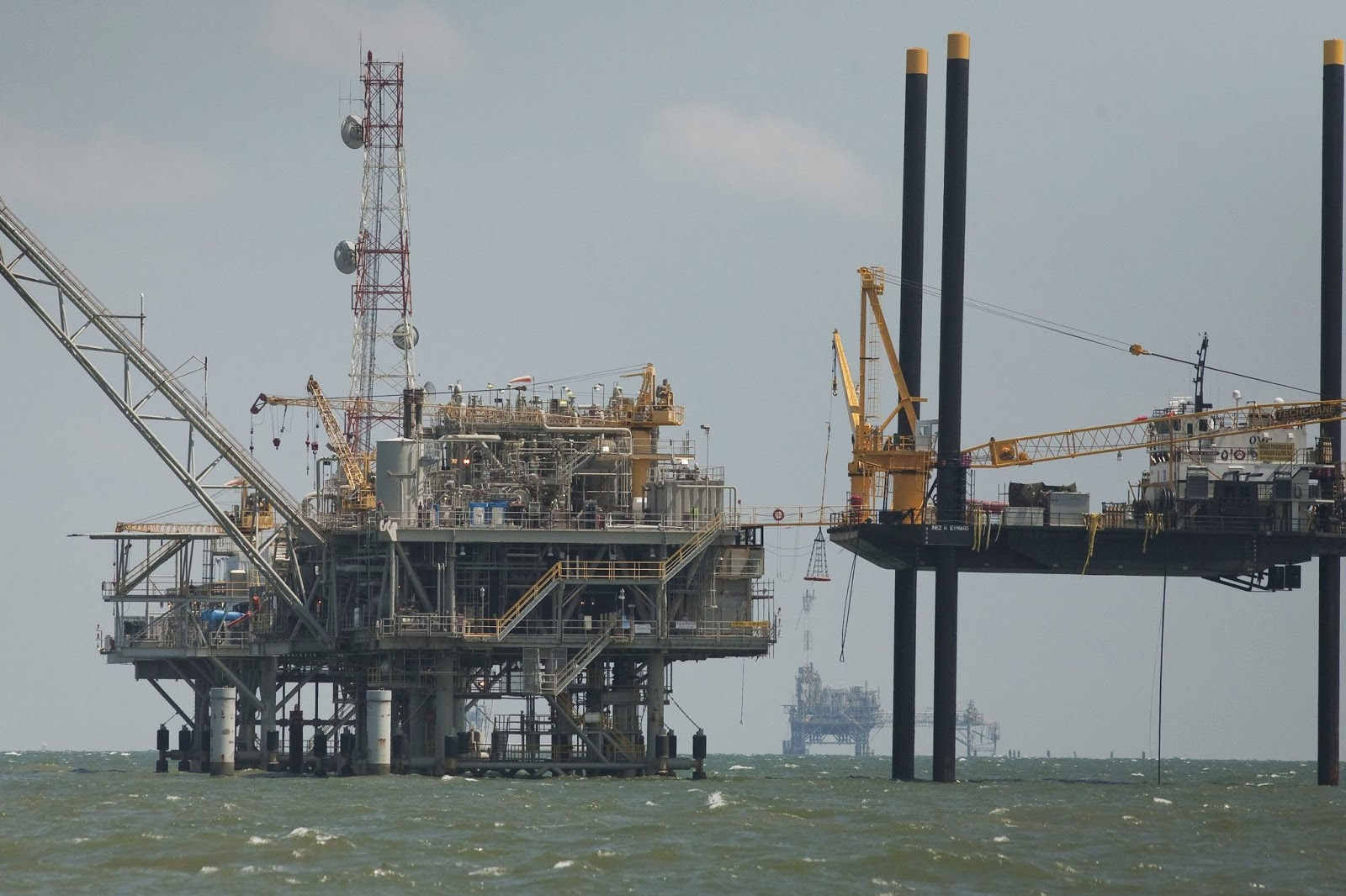 An Exxon rig in Mobile Bay, Ala. The company agreed to publish plans to cope with the risks to its assets posed by potential limits on greenhouse gas emissions. (Credit: Bevil Knapp/European Pressphoto Agency) Click to enlarge.