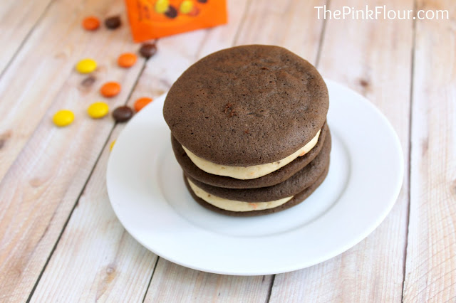 Chocolate Peanut Butter Whoopie Pies - made using a chocolate cake mix and peanut butter cream cheese frosting with Reese's Pieces. So good!