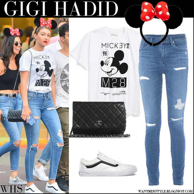 Gigi Hadid in white Neff Mickey t-shirt, ripped A Gold E jeans, Minnie Mouse ears and white Vans sneakers what she wore july 25 disneyland