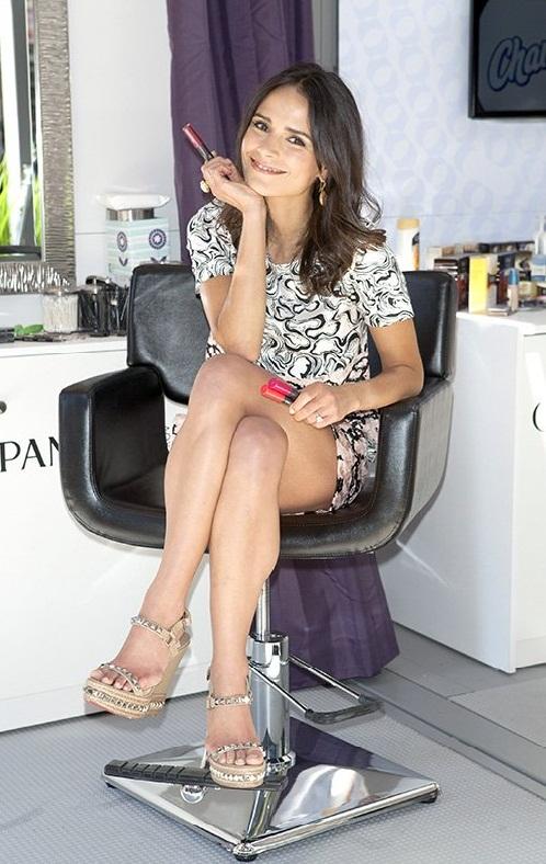 Jordana Brewster leggy sitting in a chair