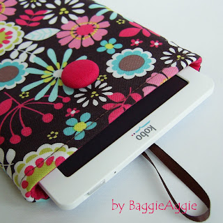 Uber pretty floral fabric Kindle sleeve in pink, blue, yellow and green on chocolate brown.