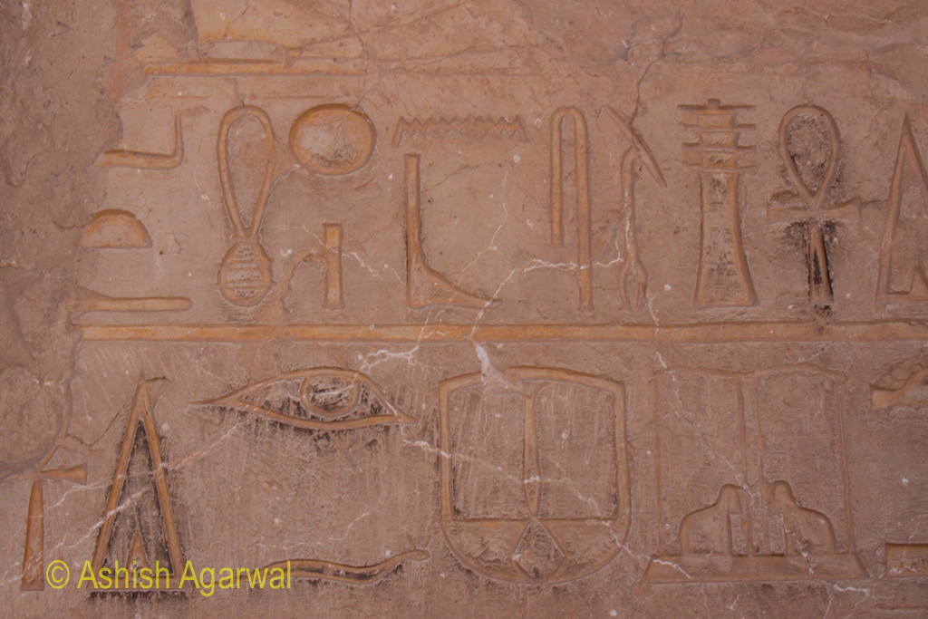 Symbols on the wall inside the Queen Hathsepsut mortuary temple near Luxor in Egypt