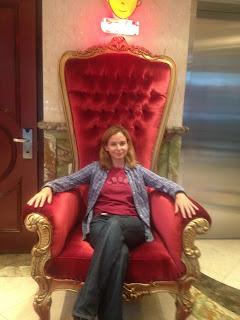 woman sitting on a throne
