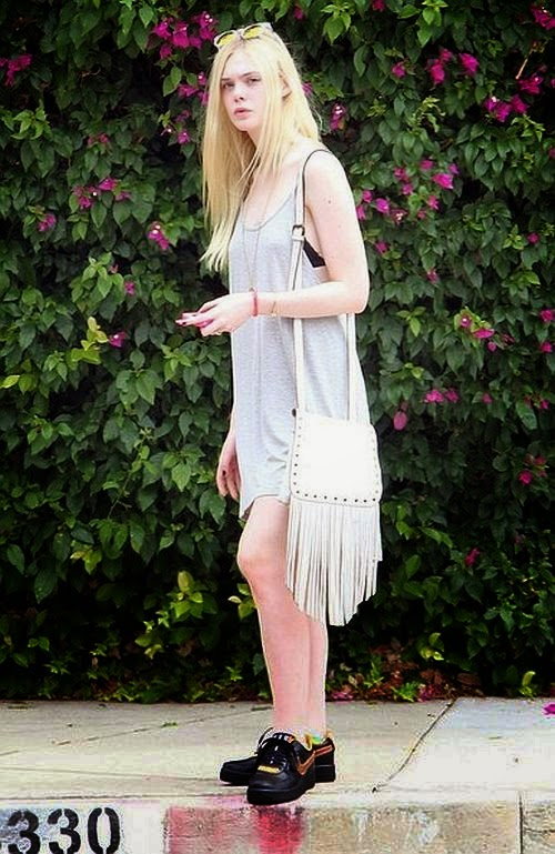 The trend is bound to always be in style, and the star works it so well. While Elle Fanning paired her cotton style with flats, you can easily dress it up or down as she spent quality time for lunch with friends in California on Saturday, August 2, 2014.