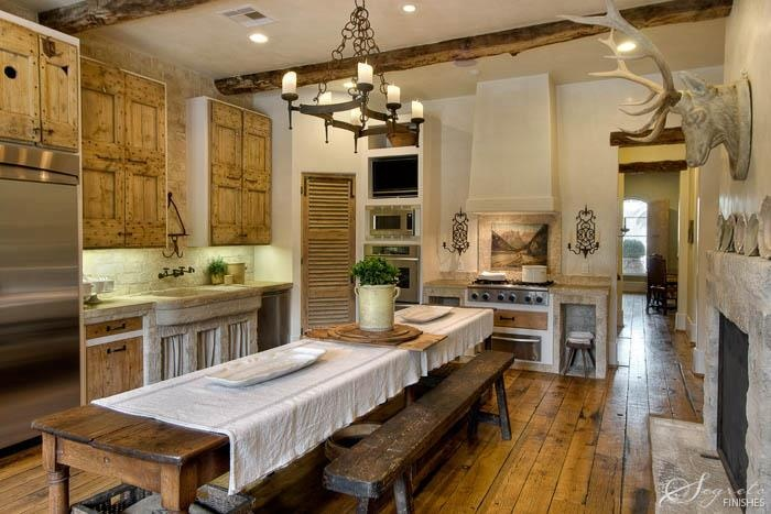consider yourself very luck if you have a fireplace in your kitchen a long harvest table is a must for the rustic farmhouse kitchen