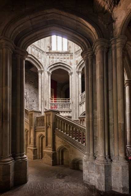 interior arch at Margam Castle and staircase by Martyn Ferry Photography