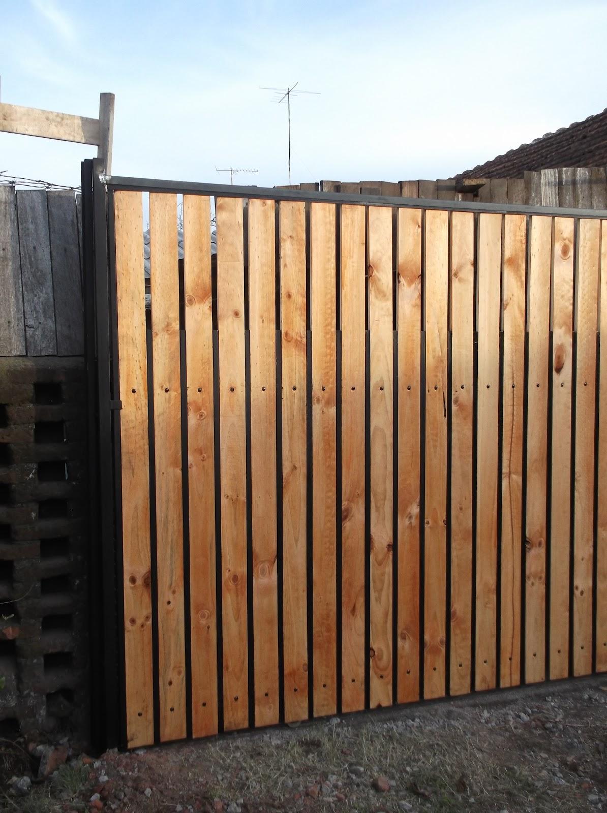 Trabajos recientes porton corredera for Bar de madera y fierro
