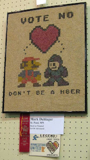 SuperMario and another game character below a heart, reading Don't be a H8ter