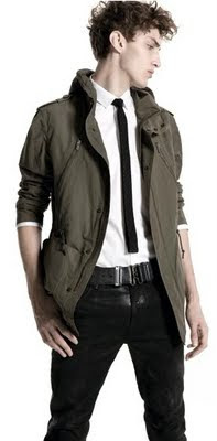 green parka, white button-up shirt, black tie, black jeans, black belt,