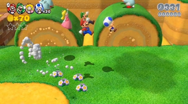 Four players jumping in Wii U game Super Mario 3D World