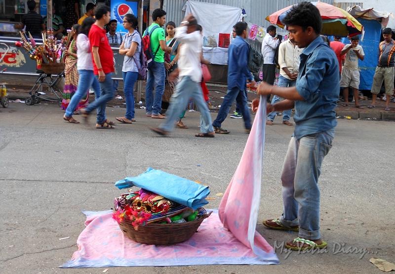 Shopkeeper opening his wares Lalbaugcha raja, Ganesh Pandal Hopping, Mumbai