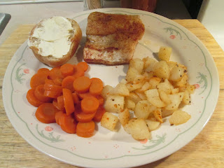 fried walleye w/ steakhouse seasoned diced potatoes, sliced carrots, and..
