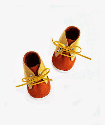 https://www.etsy.com/listing/157416686/fabric-baby-shoes-orange-yellow-cotton?ref=favs_view_7