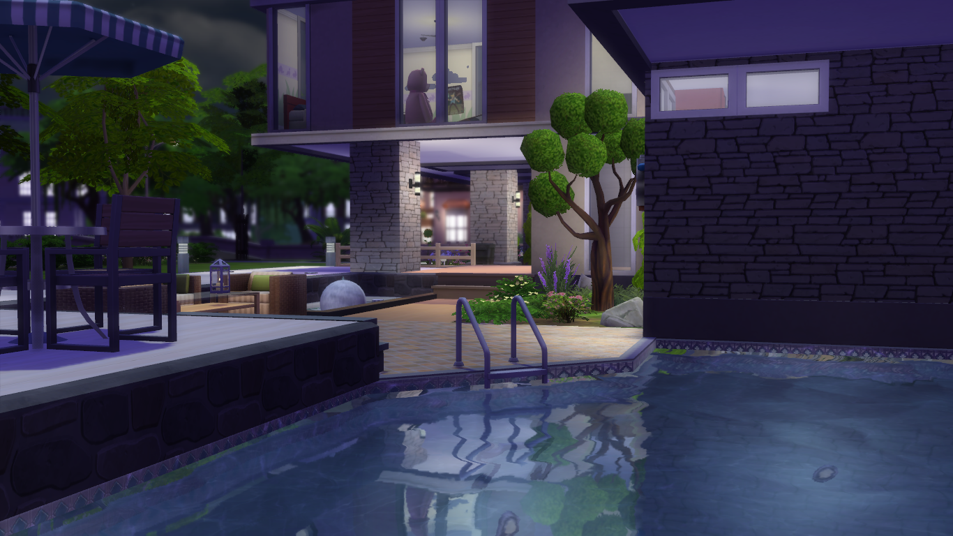 This is one of the frontal pictures of the house the right side of it under the roof is it a roof with 3 rectangle holes is the garden where your sims