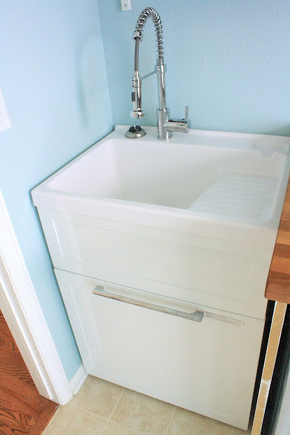 Laundry Room Utility Sink with Cabinet