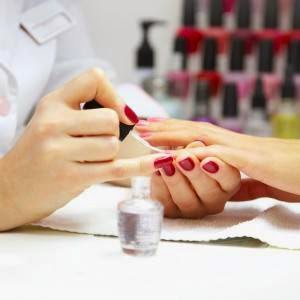 Nail polish manicure in nail salon