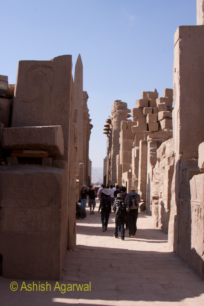 Following some people walking through the Karnak temple in Luxor