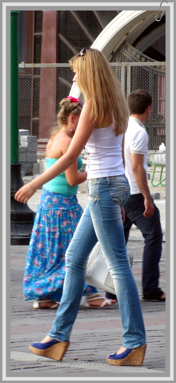 Tall Girl On The Street In Blue Jeans