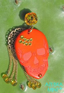 boucles d'oreille orange tête de mort