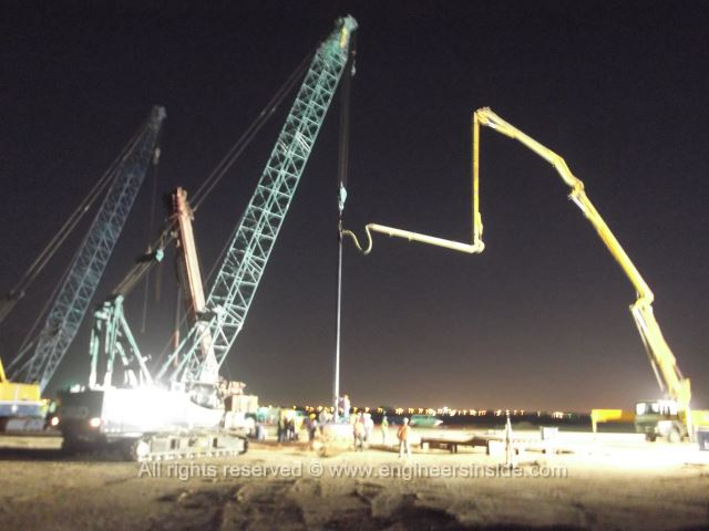 Crane and concrete pump pumping the concrete into test pile