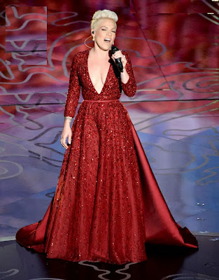 Pink in Red dress at Oscars.