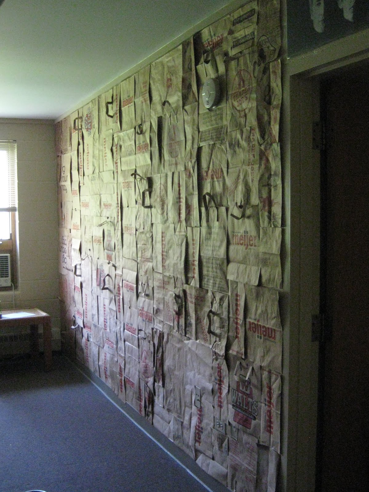 Installation brown paper bag wall hannah snow for Wall to wall paper