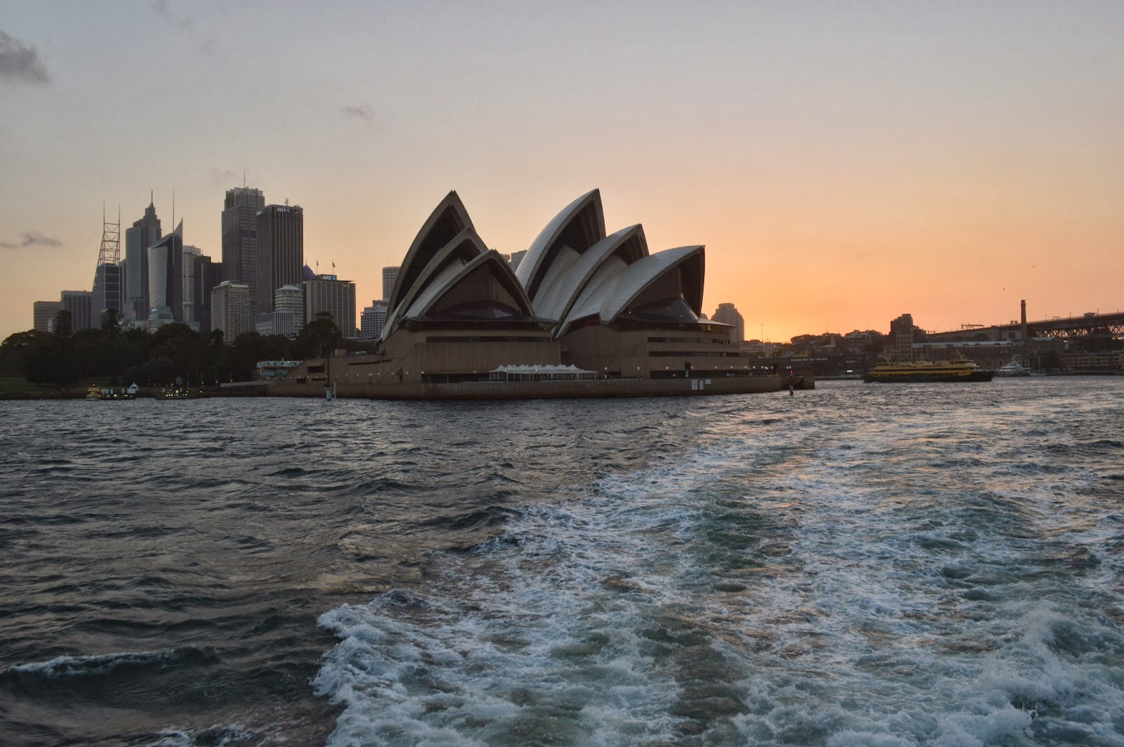 Sydney Opera House against an orange sunset.