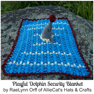 http://www.ravelry.com/patterns/library/playful-dolphin-security-blanket