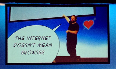 Photo of Tom Coates on stage, with speech bubble - internet does not mean browser