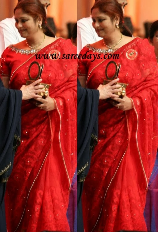 Latest saree designs jayasudha in red designer embroidery saree checkout jayasudha in red designer embroidery saree with small gold border and paired with short sleeves blouse with wide open neck pattern altavistaventures Image collections
