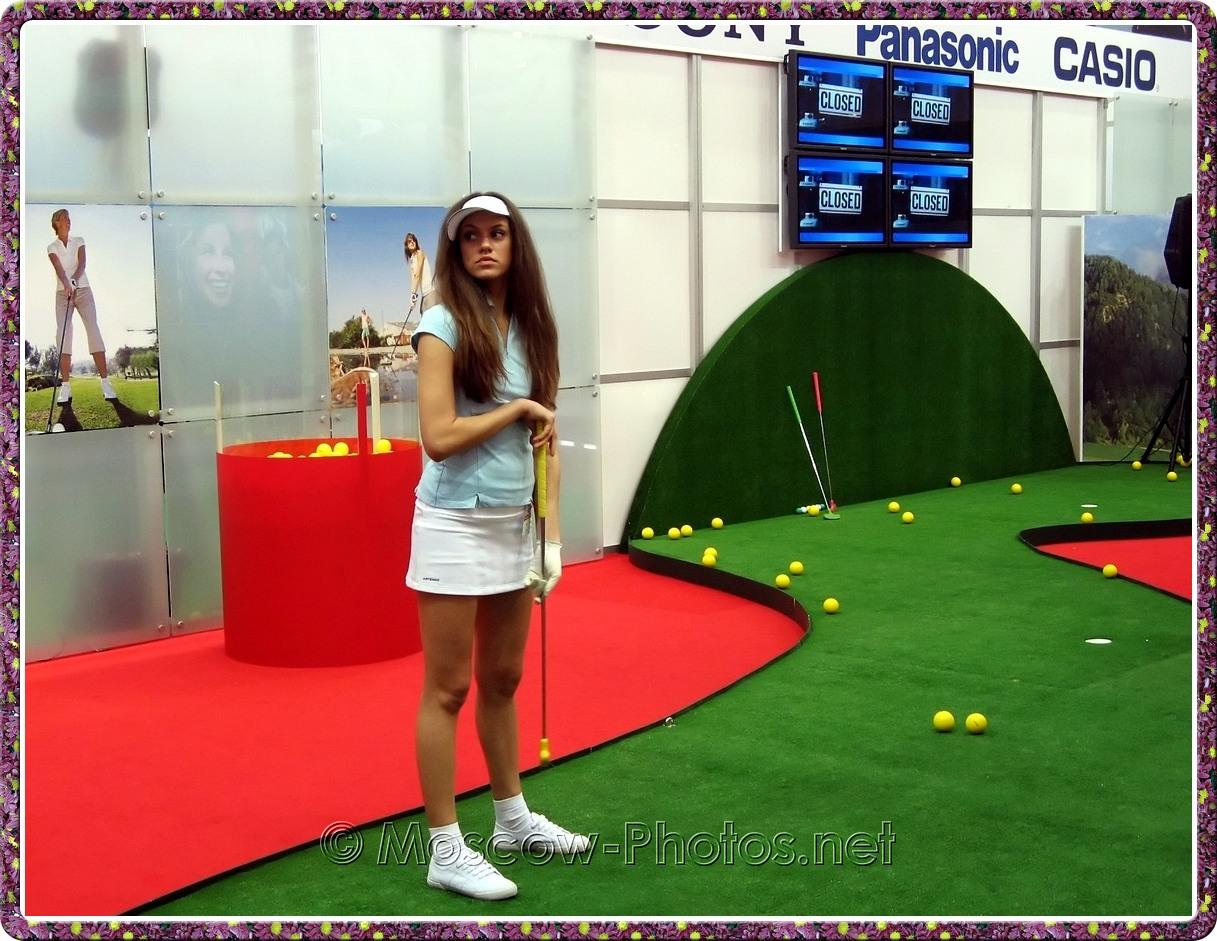 Girl plays golf at Photoforum - 2008