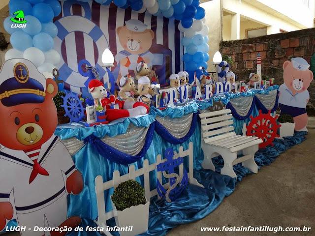 Decoração de festa infantil em mesa decorada com o tema do Ursinho Marinheiro
