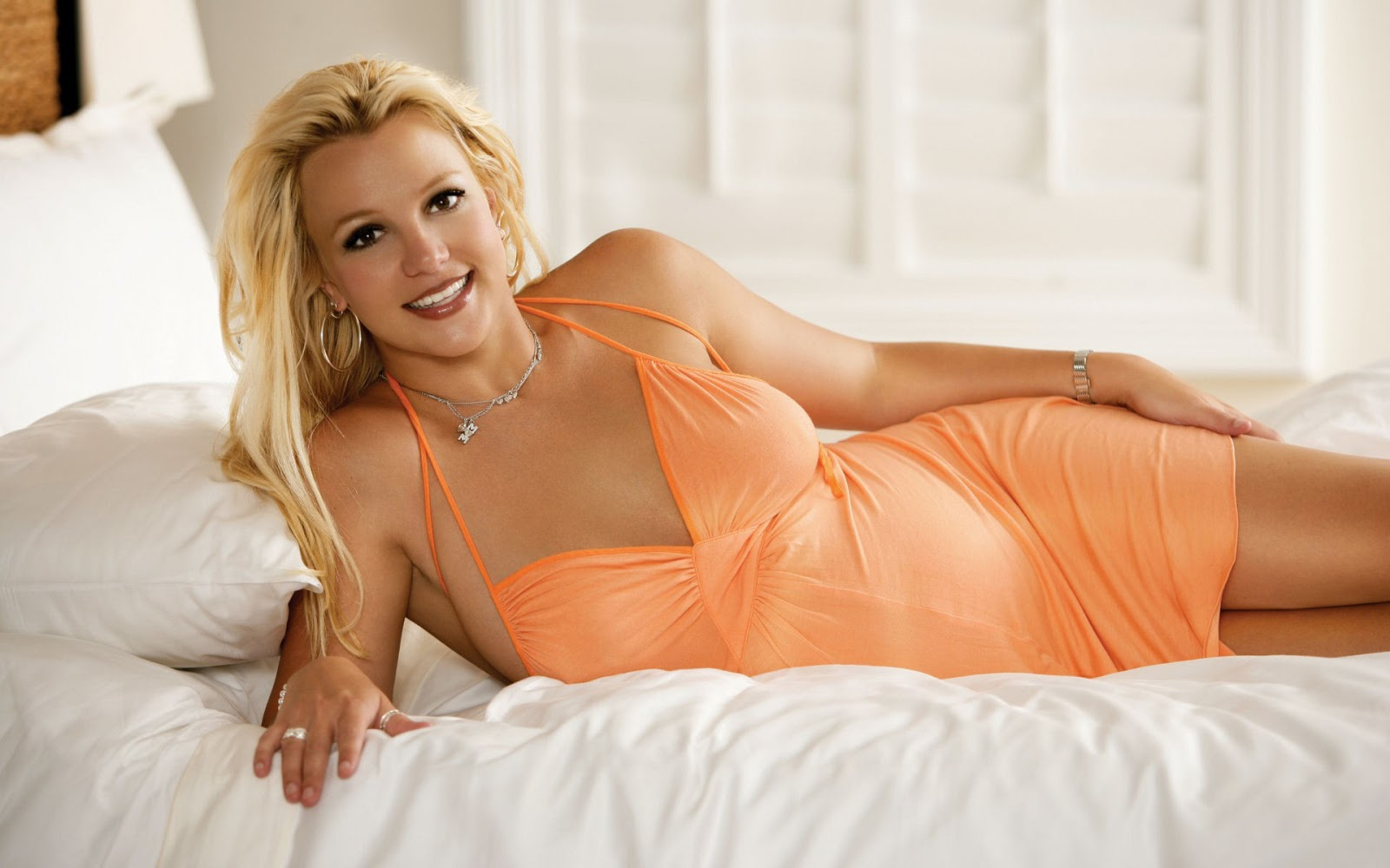Britney Spears on Bed Smiling